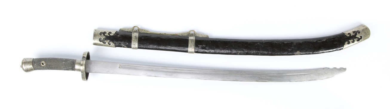 An antique Chinese saber with yanchidao blade and engraved white brass (baitong) fittings.