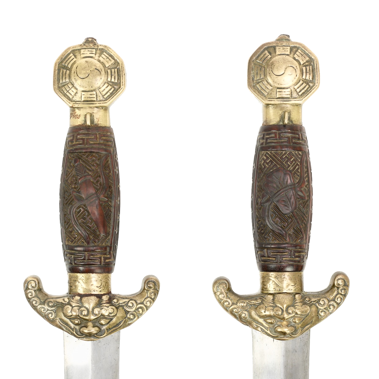 Carved wooden hilts on antique Chinese double swords. Guangzhou, 1830 - 40's