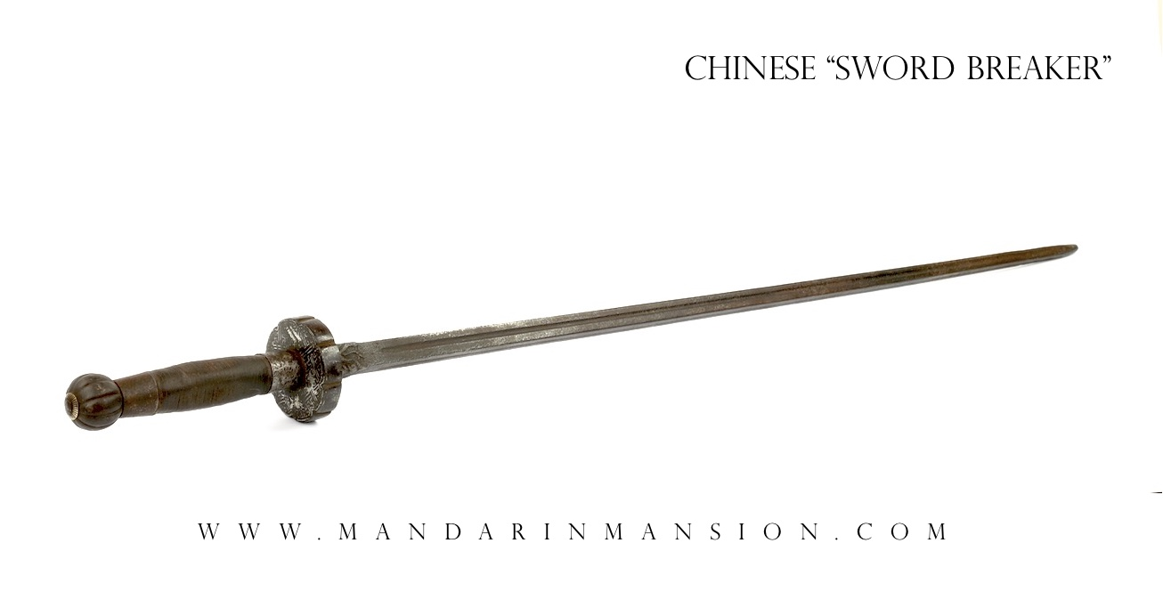 A large Chinese sword breaker of the jian type, a smooth mace.