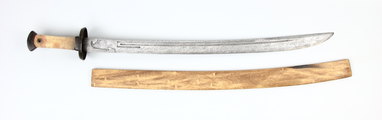 An antique Chinese saber with twist-core blade and U-turn grooves. www.mandarinmansion.com