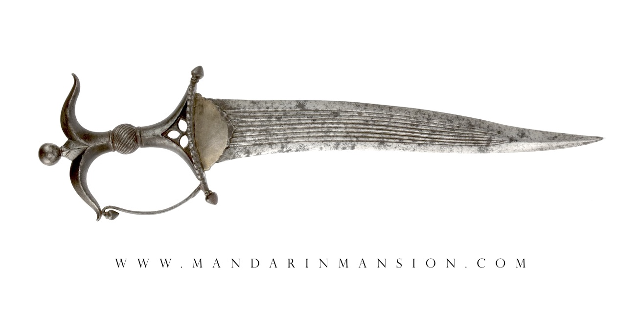 A fine Deccan Chilanum dagger with characteristic all steel hilt. Of robust form with with fine flower bud finials.