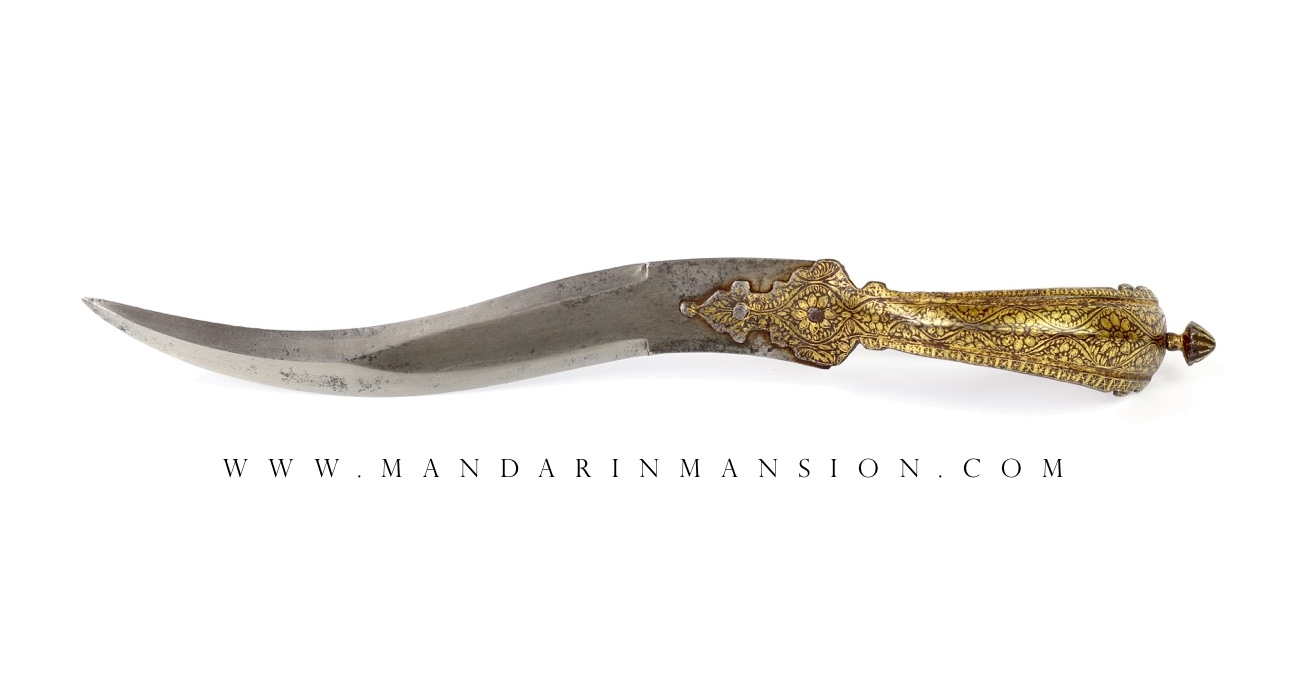 A bichwa dagger with fine gold decorated handle
