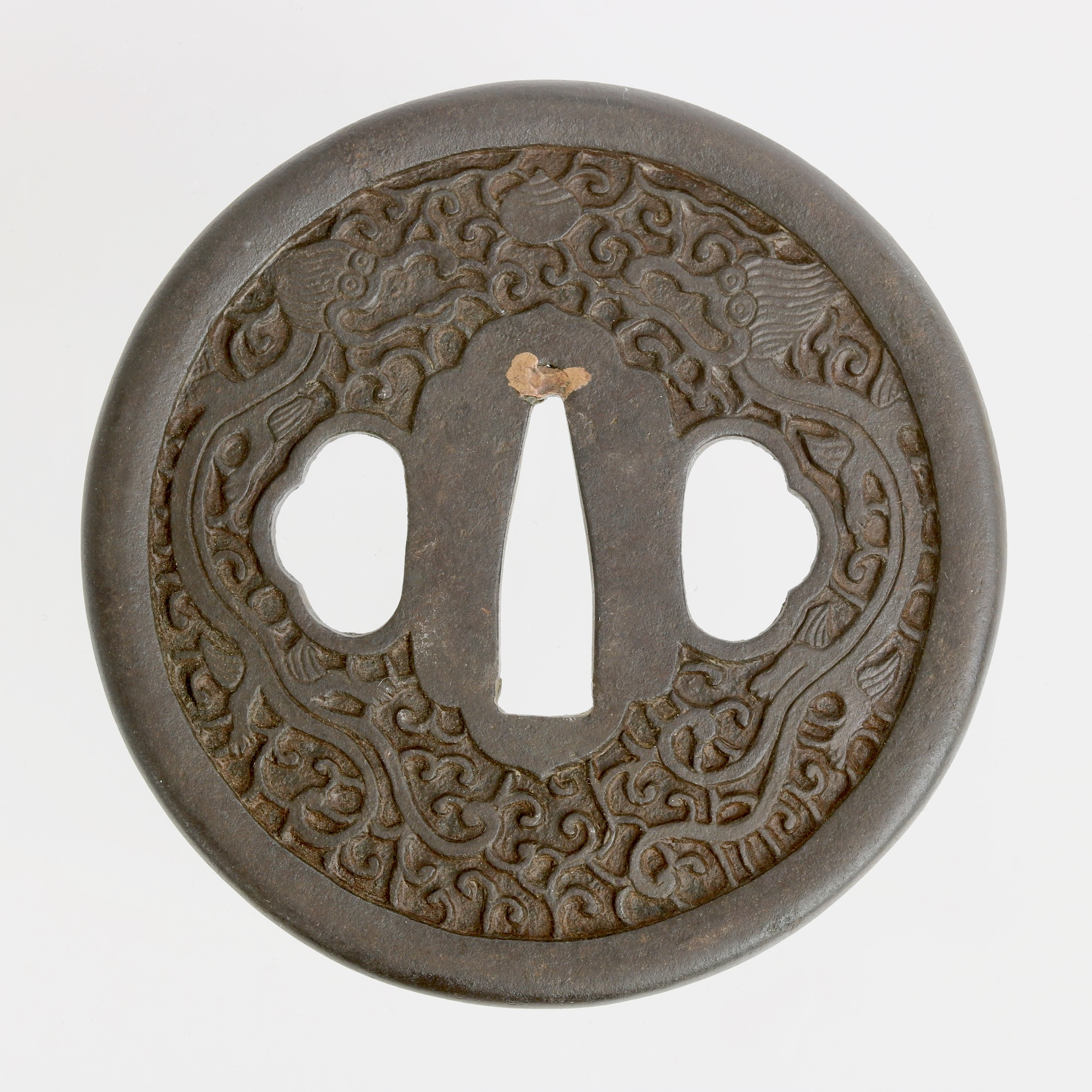 A Japanese sword guard, inspired by Chinese design.