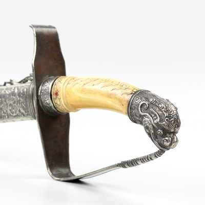 An excellent antique Vietnamese saber with mother-of-pearl inlaid scabbard, ivory hilt and silver mounts.