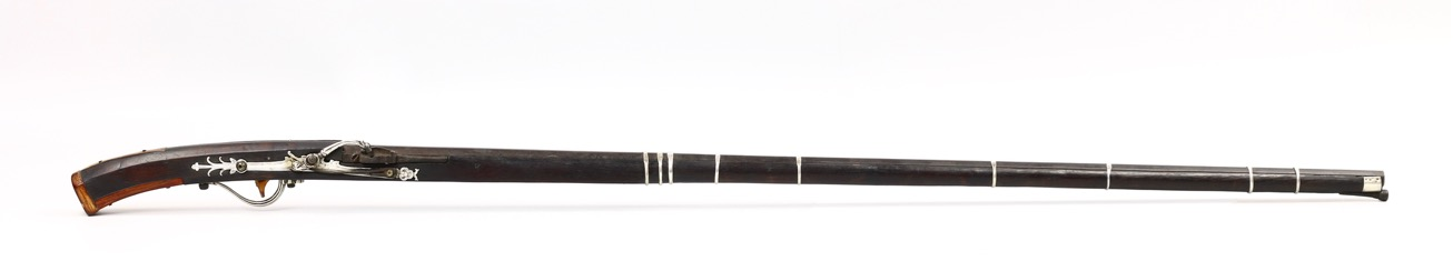A rare Vietnamese matchlock musket of the 18th century, with all-silver lock.