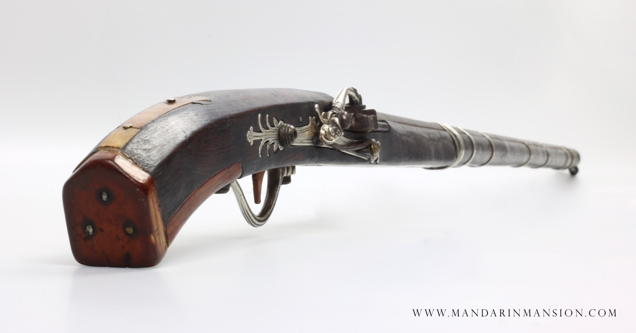 A rare 18th century Vietnamese matchlock musket with ivory butt plates and all-silver lock and mountings.